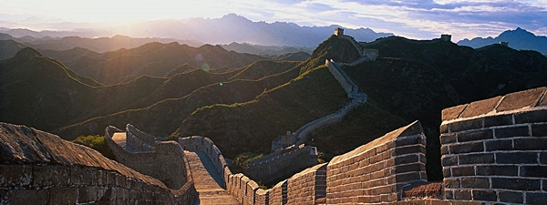 The Great Wall of China climbs over hills into the distance