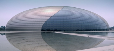 The National Centre for the Performing Arts, or the Egg, and a reflecting pool, in Beijing, China