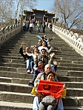 A China International Travel CA tour group holding a CIT banner