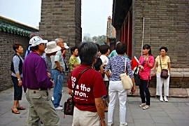 A China International Travel CA tour guide shares insights with her group