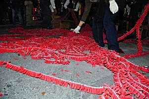 extremely long strings of Chinese New Year firecrackers in Taipei, Taiwan