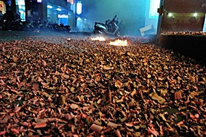 a street covered by firework remnants left behind by Chinese New Year firecrackers in Taipei, Taiwan