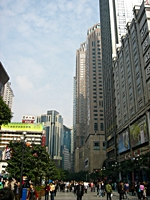 Skyscrapers rise high above a pedestrian street in downtown Chongqing (重庆), China