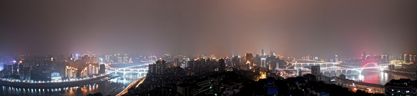 Panoramic view of the winding Yangtze River and the bright lights of downtown Chongqing at night