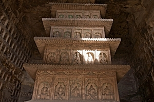 A pagoda-shaped structure covered with carvings of Buddhas at the Yungang Grottoes near Datong (大同), China