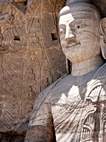 A closeup of a large Buddha statue at the Yungang Grottoes near Datong (大同), China