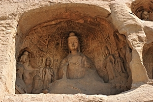 A grotto dominated by a statue of the Buddhist goddess Guanyin at the Yungang Grottoes near Datong (大同), China