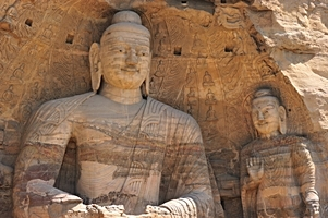 Large Buddha statues that appear to be painted carved from different rock strata at the Yungang Grottoes near Datong (大同), China