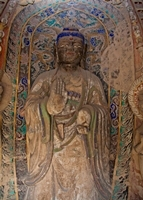 A carved and painted Buddha statue at the Yungang Grottoes near Datong (大同), China