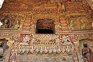 Intricately carved and painted Buddhist figures and designs at the Yungang Grottoes near Datong (大同), China