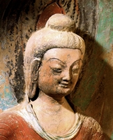 The head and shoulders of a Buddhist statue at the Mogao Caves near Dunhuang (敦煌), China