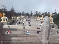 A view of Buddhist elephant statues down the long stairway leading to the Golden Summit (金顶) at Mount Emei or Emeishan (峨眉山) in Sichuan Province, China