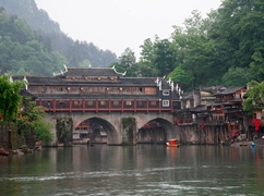 Traditional architecture covers the top of the Hong Bridge over the Tuo River in Fenghuang (凤凰), Hunan Province, China