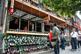 Empty beer bottles decorate the facade of a bar in Fenghuang (凤凰), Hunan Province, China