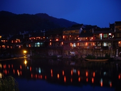 Night falls on the waterfront houses lining the Tuo River in Fenghuang (凤凰), Hunan Province, China