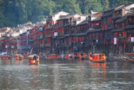 Rows of traditional red paper lanterns hang on the waterfront buildings of Fenghuang (凤凰), Hunan Province, China