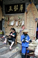 Sellers of traditional thong sandals at work in Fenghuang (凤凰), Hunan Province, China