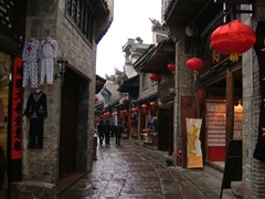 Shops selling all manner of goods and souvenirs line a narrow village lane in Fenghuang (凤凰), Hunan Province, China