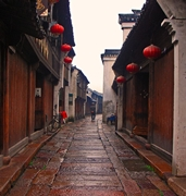 A local man walks along a narrrow village lane in Fenghuang (凤凰), Hunan Province, China