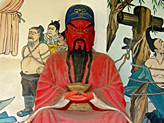 A red-faced statue of the Chinese general and deity Guan Yu