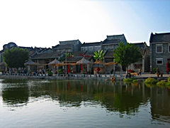 Lingnan-style buildings line a lake in Lingnan Impression Park in the Panyu District of Guangzhou, China