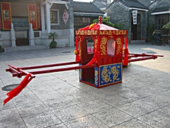 A traditional Chinese palanquin on display at Lingnan Impression Park in the Panyu District of Guangzhou, China