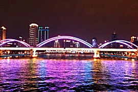 A colorfully lighted bridge across the Pearl River in Guangzhou, China