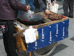 A chestnut vendor in downtown Guangzhou, China