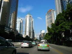 A street passes under skyscrapers and a blue sky in downtown Guangzhou (广州), China