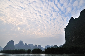 Furrowed cloud formations in the sky above the karst hills of the Li River (漓江) in Guilin (桂林), China