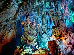 Limestone formations illuminated by multicolored lights in Reed Flute Cave (芦笛岩), Guilin (桂林), China