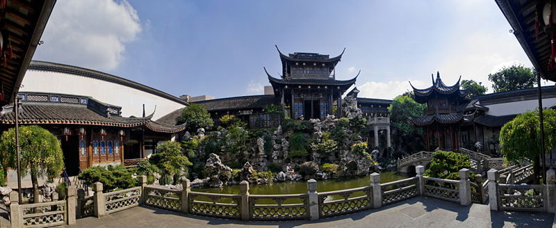 A wide-angle shot of a landscaped garden with a pond and pavilion at the opulent residence of Hu Xueyan in Hangzhou (杭州), China