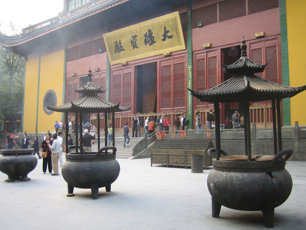 Smoke rises from giant censers in the courtyard of Lingyin Temple in Hangzhou (杭州), China