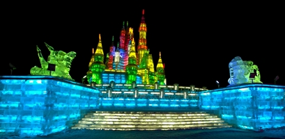A wide-angle shot of brilliantly lit ice towers at Ice and Snow World in Harbin, China