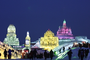 Crowds enjoying massive ice sculptures at Ice and Snow World in Harbin, China