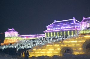 Crowds of people climb up sprawling ice stairways at Ice and Snow World in Harbin, China