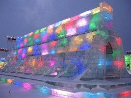 An ice structure illuminated by multicolored lights at Ice and Snow World in Harbin, China