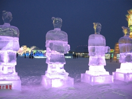Glowing terracotta soldiers made of ice at Ice and Snow World in Harbin, China