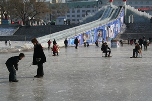 People playing on an ice rink in Harbin, China