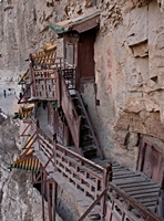 Stairways and walkways cling to the cliff face at the Hanging Temple, Hanging Monastery, or Xuankong Temple on Mount Heng (恒山), China
