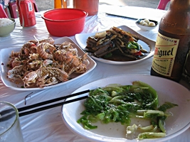 Food and beer at a seafood restaurant on the waterfront of Hong Kong's Cheung Chau Harbor
