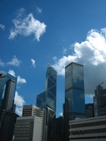 Glass-sided skyscrapers (the Bank of China Tower and the Cheung Kong Centre) reflect a cloudy sky in downtown Hong Kong