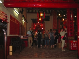 Tourists absorbing the Taoist atmosphere of Man Mo Temple in downtown Hong Kong