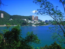 Green vegetation, blue water, and blue sky at Hong Kong's Repulse Bay