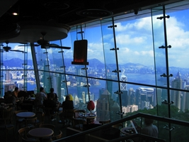 A view of Victoria Harbour and skyscrapers in downtown Hong Kong from a cafe in the Peak Tower
