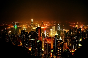 A night view of Victoria Harbour and the brightly lit skyscrapers of downtown Hong Kong and Kowloon from Victoria Peak