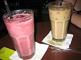 A refreshing fruit smoothie and iced milk tea in downtown Hong Kong's Kosmo Wellness Cafe