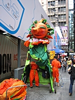 A human billboard puts a costume on to advertise on the streets of downtown Hong Kong