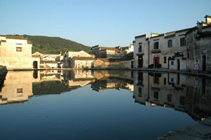 Buildings lining Moon Pond in Hong Village (Hong Cun, 宏村), near Huangshan (Yellow Mountain), China, reflect off the surface of the water