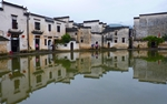 Reflected Buildings on Hong Village's Moon Pond - Desktop Wallpaper - 1280 x 800 - thumbnail